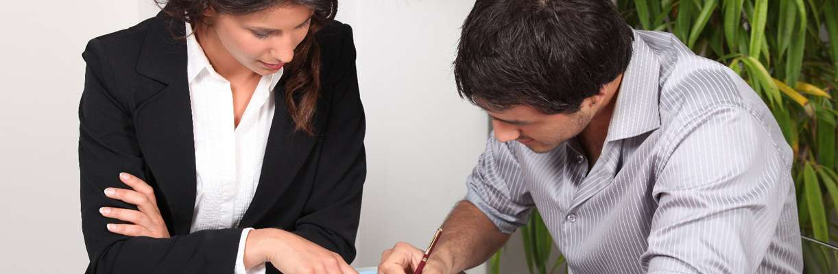 A franchise unit owner works with a loan officer to obtain a loan for construction