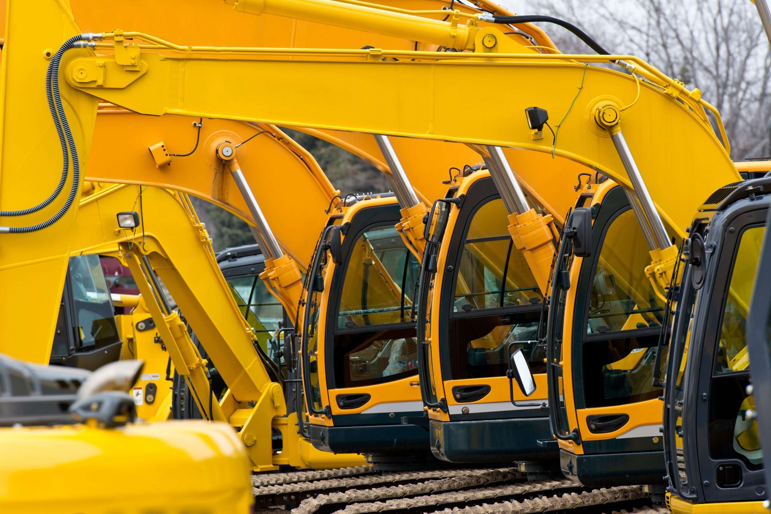 Multiple excavators in a row are an example of the assets a business can borrow against.