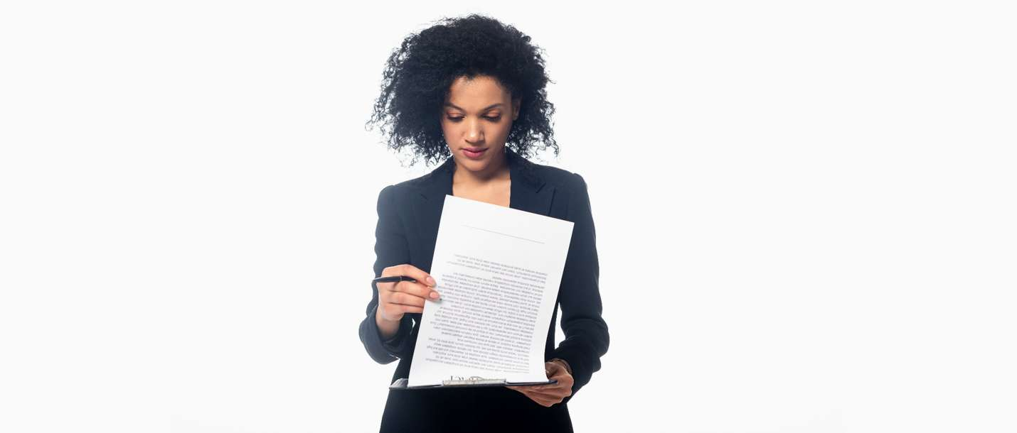 A person holds and reviews a document on commercial leases