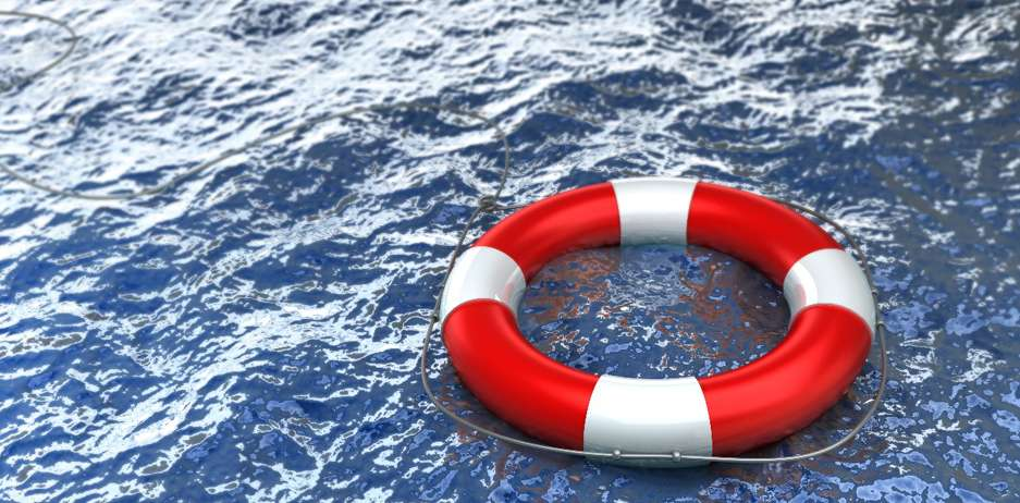 A life preserver floats in water, representing the importance of the protection afforded through small business insurance