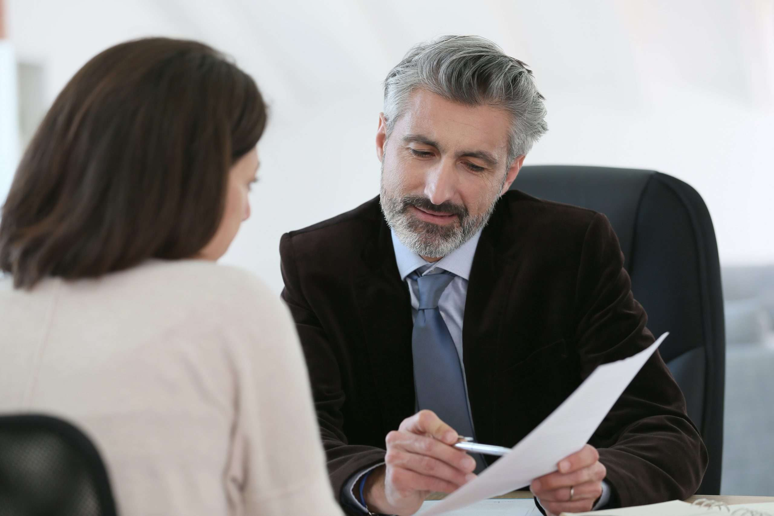 An attorney meets with a small business owner.
