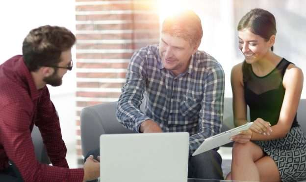 Three people work together to form a business strategy
