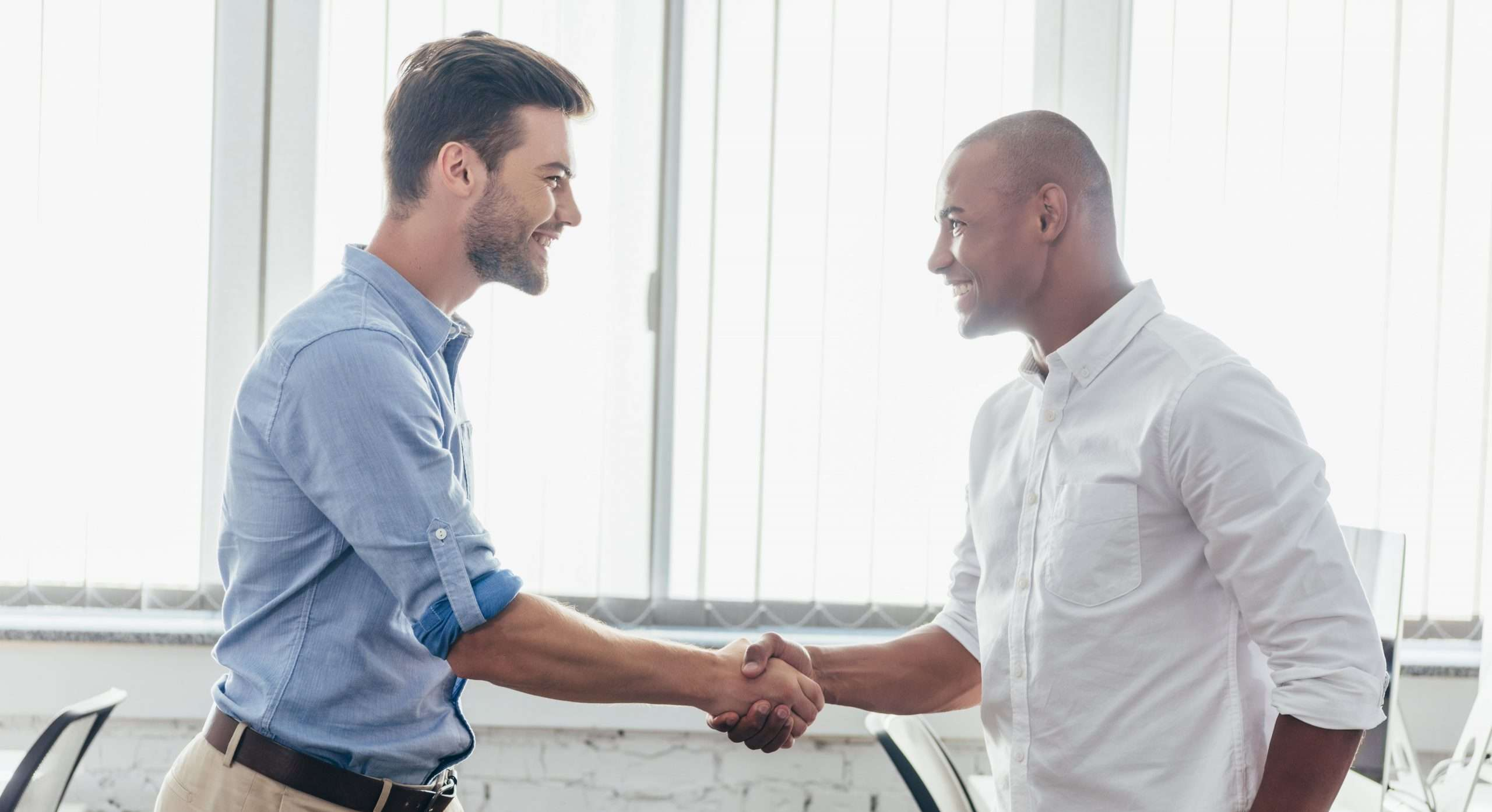 A person shakes hands with a registered agent