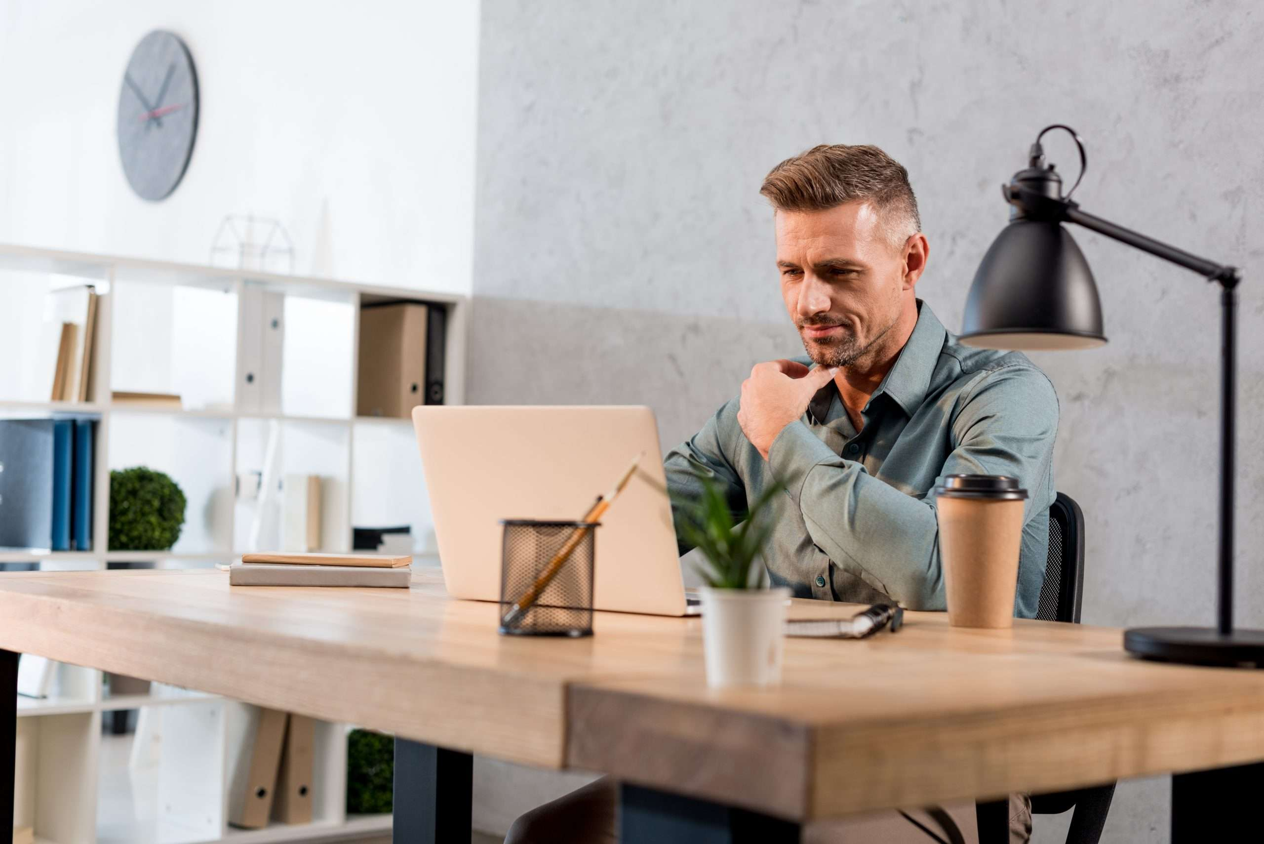 A person sitting at a desk plans to change his business structure