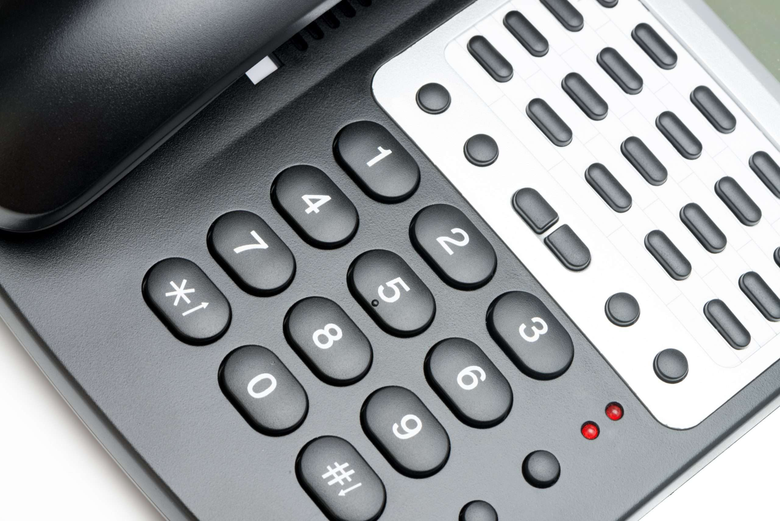 A close up of an office phone