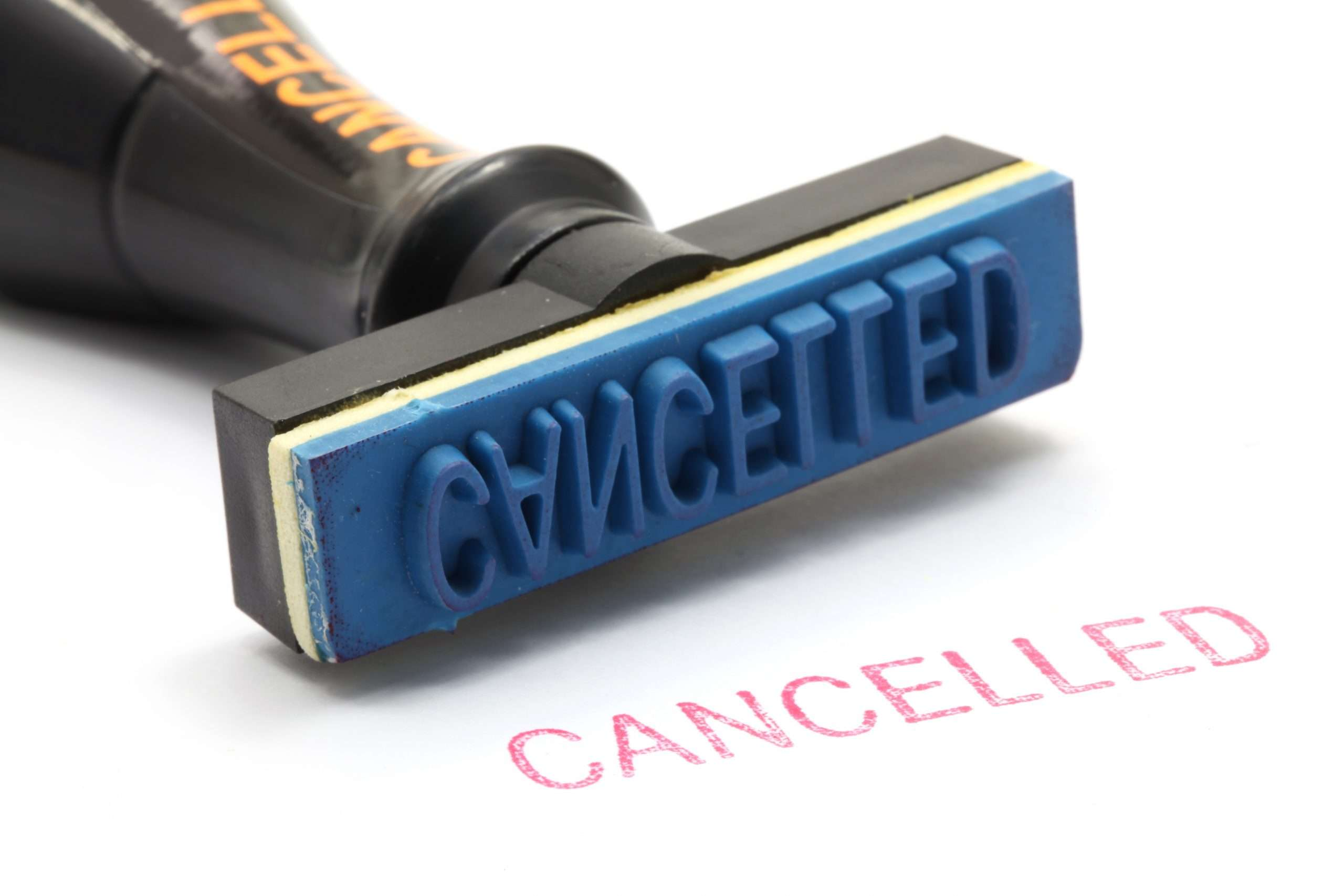 A rubber stamp with the work cancelled that can be used as you cancel services and subscriptions for your small business