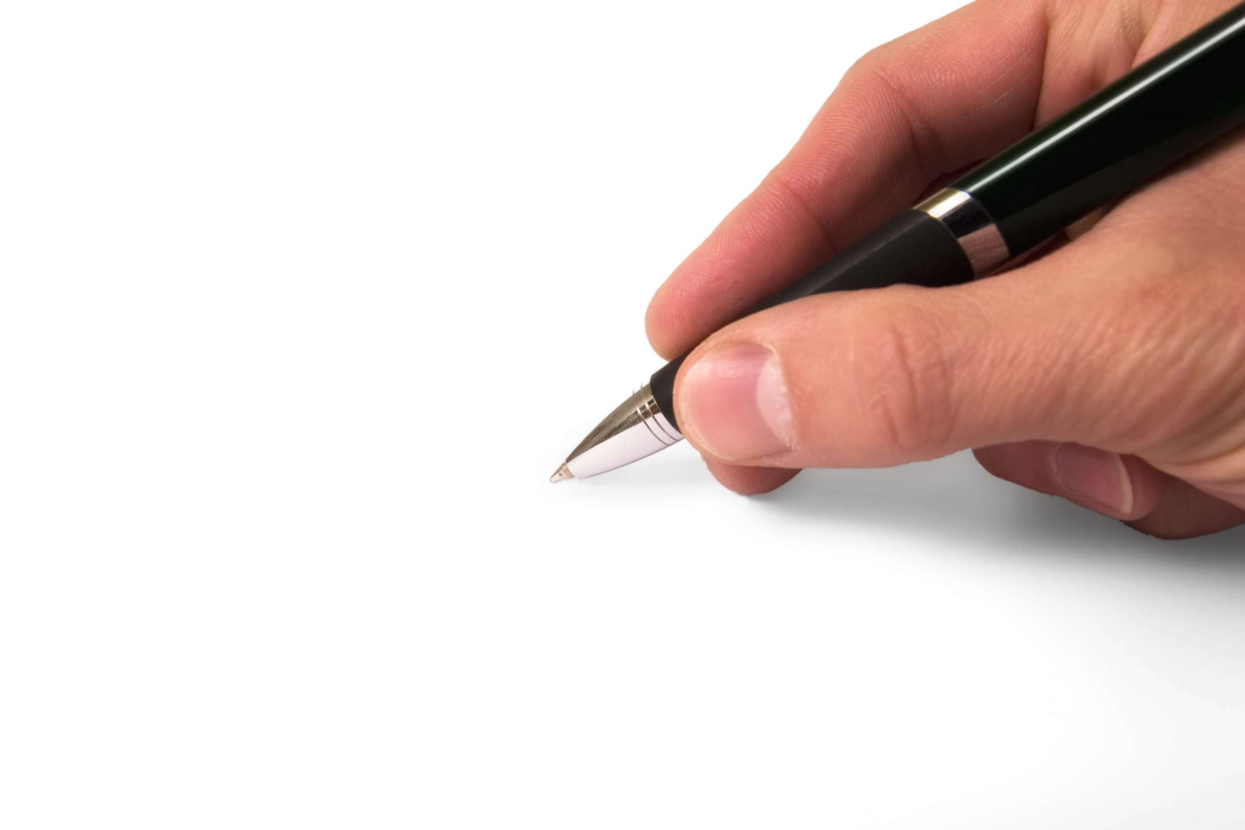 One of a business's authorized signers prepares to sign a contract