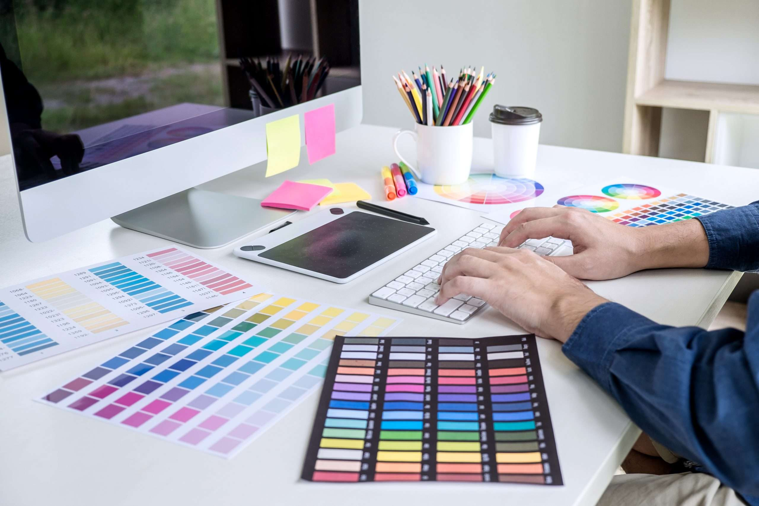 A designer works on creating a logo for a business.
