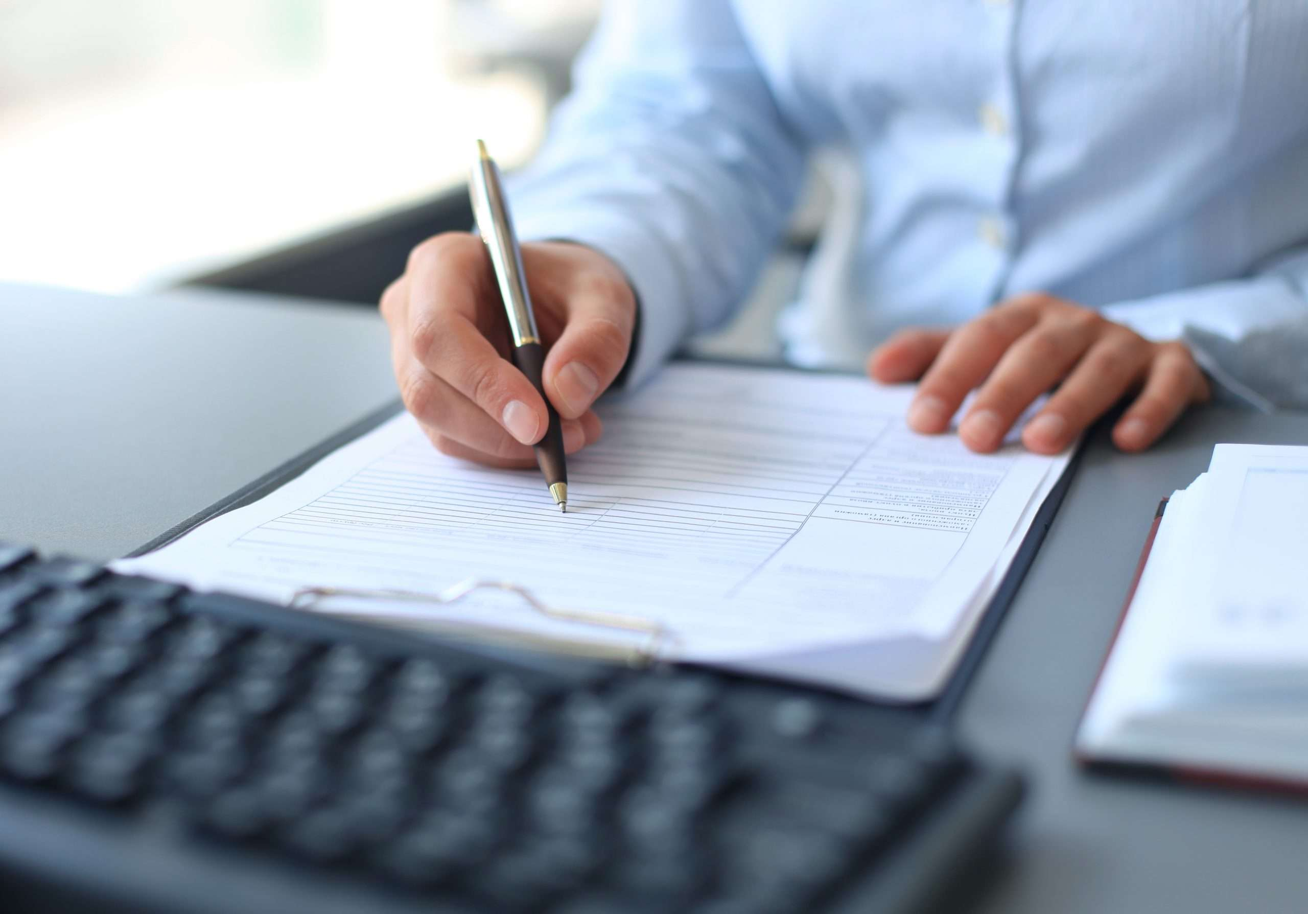A business owner completes a checklist of items to bring to meet with a business broker