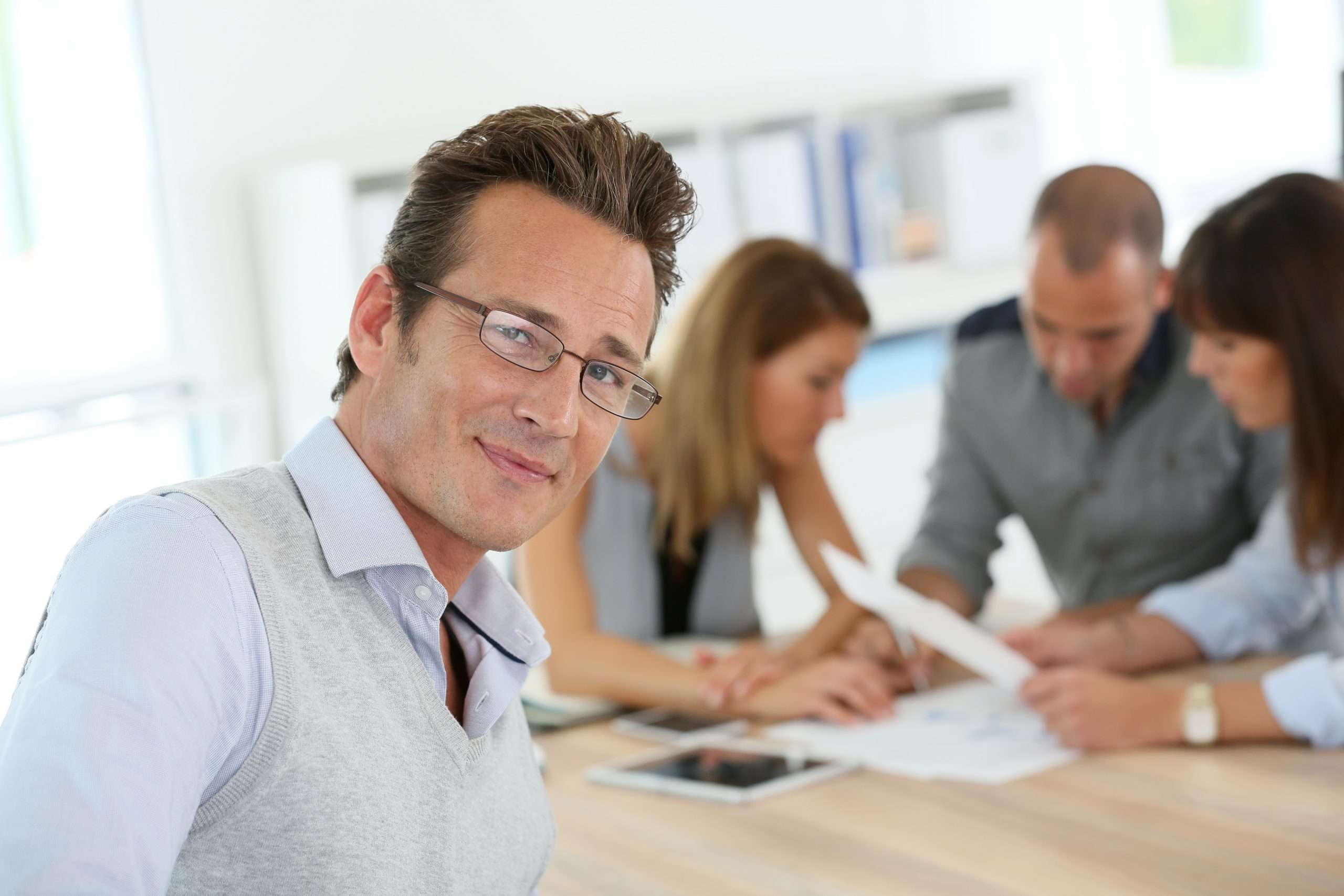 A person works with others to fulfill a post-sale training commitment