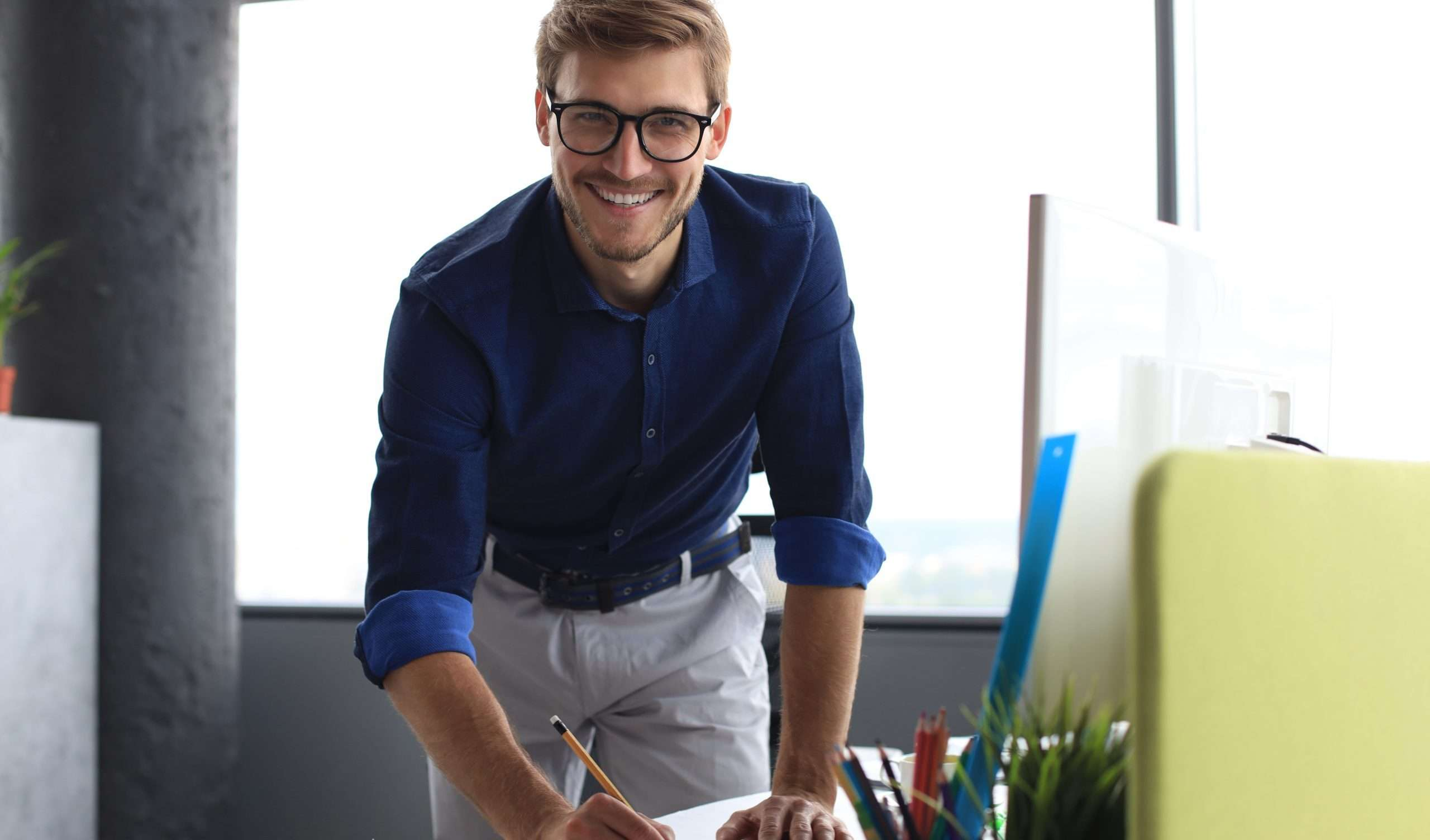 A professional in an office uses business ratios to gauge his success.