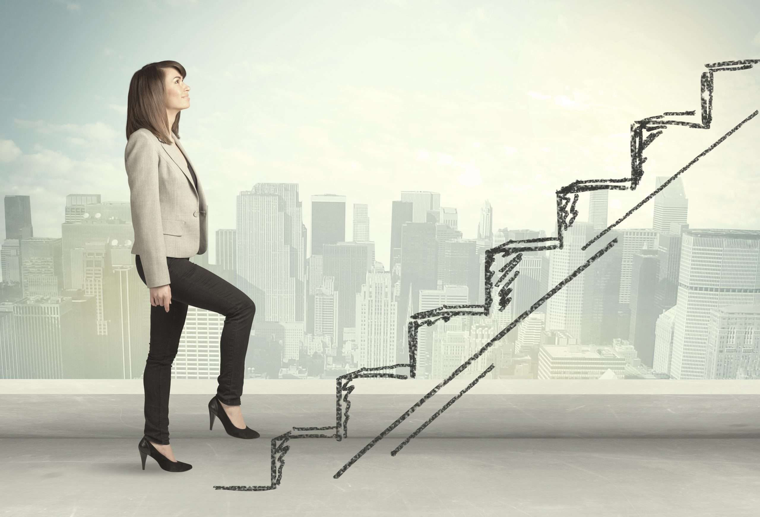 A business professional climbs an line-drawn staircase to emphasize how small business loans can help people climb to higher tiers of success.